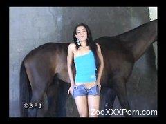 Skinny brunette fucks with hardcore horse in the barn
